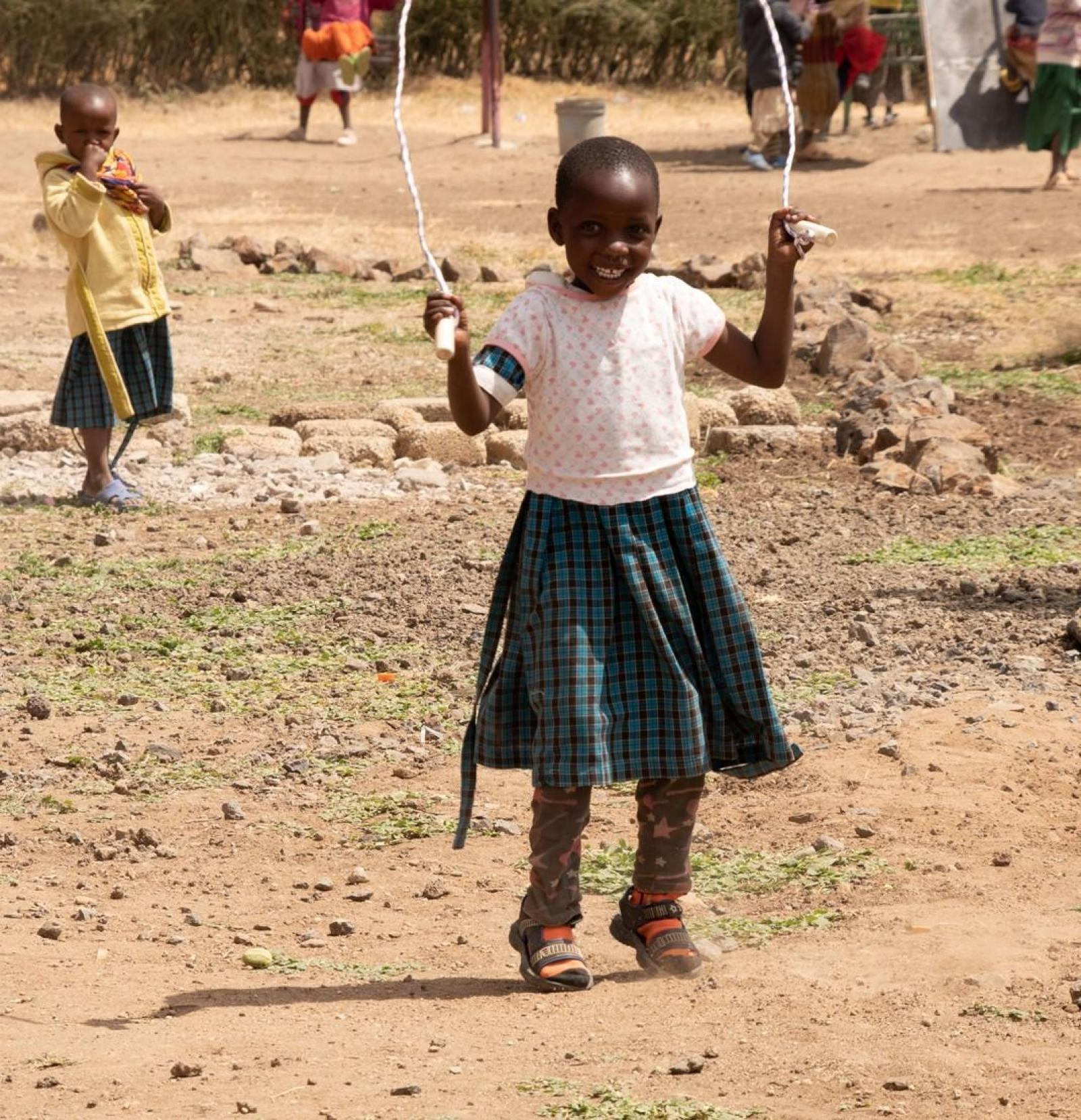 A child skipping at a school in Tanzania